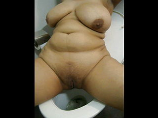 Big chested Indian Chick Peeing