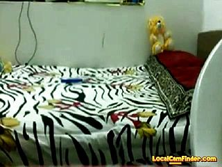 Desi teenager frolicking with herself on web cam