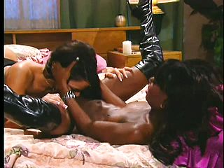 On the sofa a bashing dark haired and a tasty ebony doll fulfill their all girl dreams